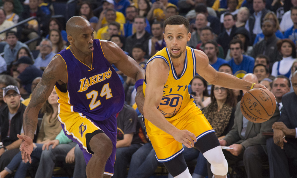 November 24, 2015; Oakland, CA, USA; Golden State Warriors guard Stephen Curry (30) dribbles the basketball against Los Angeles Lakers forward Kobe Bryant (24) during the third quarter at Oracle Arena. The Warriors defeated the Lakers 111-77. Mandatory Credit: Kyle Terada-USA TODAY Sports
